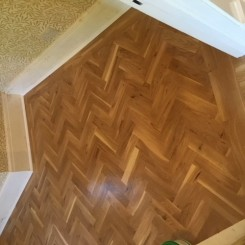 Rustic Oak Blok Flooring – laid in herringbone design with two strip border.